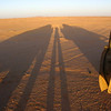 Our expedition larger than life as evidenced by the long shadows of Flip and two 4WDs at sunset in the desert