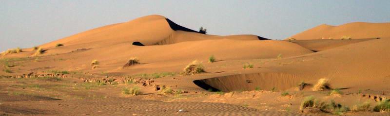 Dunes along the roadside from Ashgabat to Darvaza in rural Turkmenistan