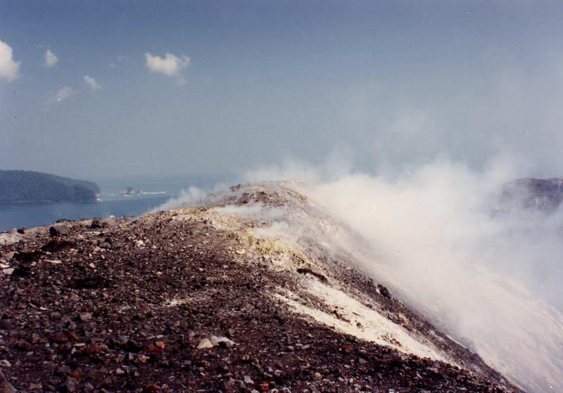 Smoldering fumeroles astride the rim of the caldera of Anak Anak Krakatoa