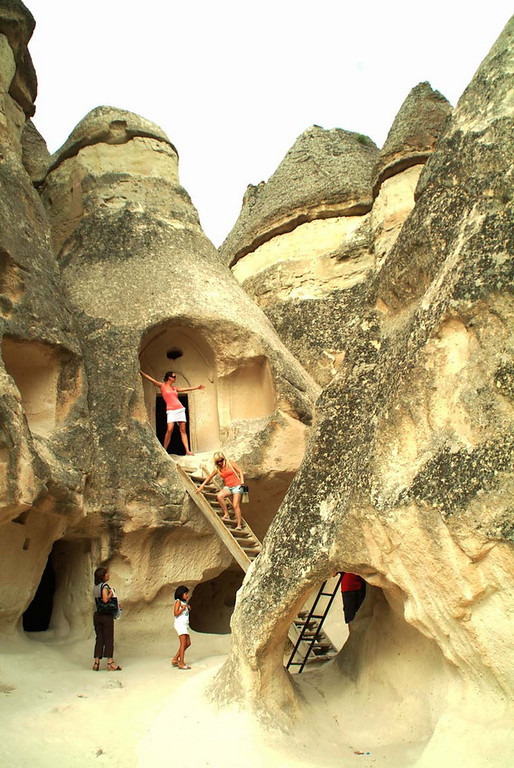 Scenic carved out dwellings and chapels amongst the Devrent Pasa Baglari (Fairy Chimneys) in Kapydokia Turkey.