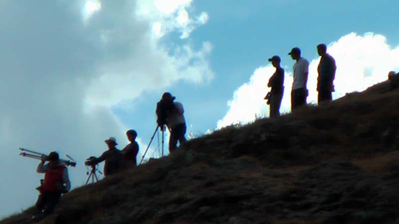 Photo and videographers line the hillside above the Inti Raymi celebrations in Sacsayhuanman near Cuzco Peru.