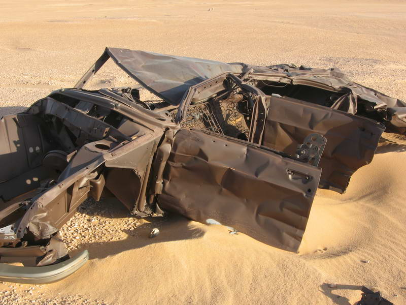 A truly spectacular wreck amongst the abandoned Peugeot cars that line the desert trek from the Niger-Algeria border to Tamarasset