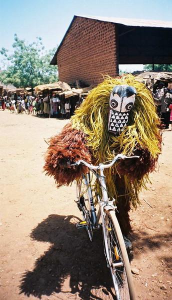 """Bad"" Spirit mask rides a bike in the village of Pouni"
