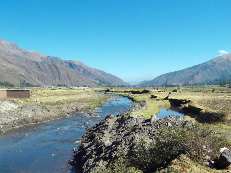Scenic river on the floor of the Urubamba valley near Pisac in rural Peru.