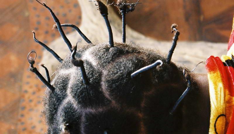 Textural hair fashion in rural Berkina Faso.