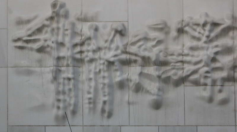 Contemporary carved stone wall relief from a nameless building in the streets of Cologne, Germany.