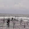 Stilt fisherman challenge the sea near Galle,Sri Lanka before the Tsunami