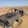 Flip takes a spin in one of the abandoned Peugeot cars that line the desert trek from the Niger-Algeria border to Tamarasset