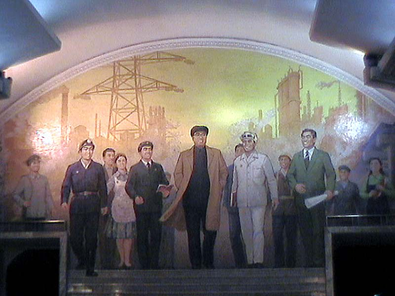 The proletariat marches forward at the top of the stairs in a Pyongyang subway station in North Korea