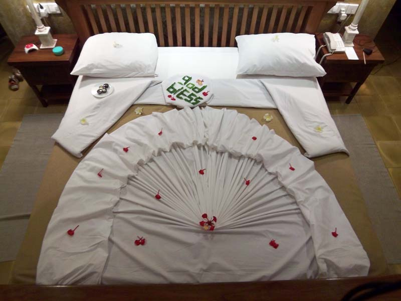 Sweet bespoke bed decorations await us at our beachside hotel in Sri Lanka
