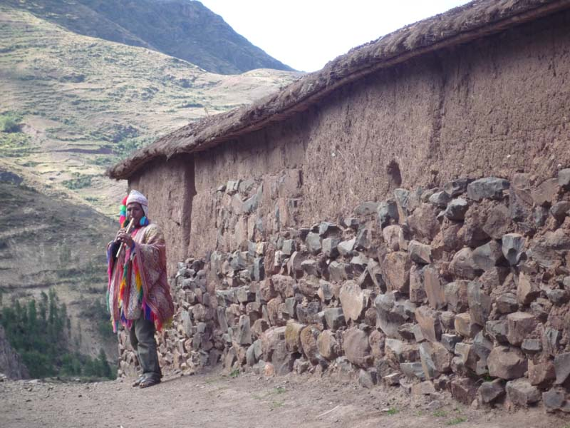 Lone flautist serenades the mountains in Pisac, Peru.