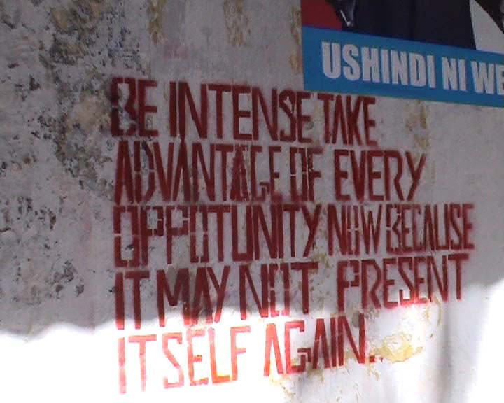 Words of wisdom on the market wall in Zanzibar.