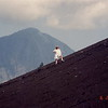 Maggie strikes a pose on the first outer inclined cinder cone of Anak Anak Krakatoa, Indonesia