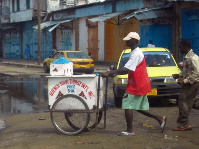 Optimistic ice cream seller on the deserted streets of Monrovia, Liberia.