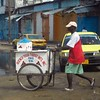 Optimistic ice cream seller on the deserted streets of Monrovia, Liberia.