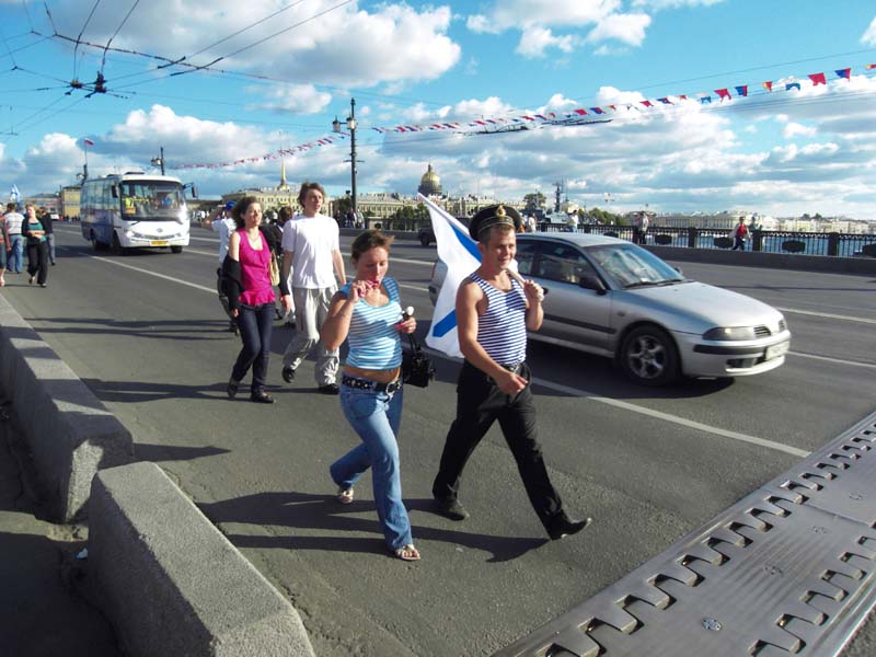 Navy Day revelers stroll through the streets of St Petersburg, Russia.