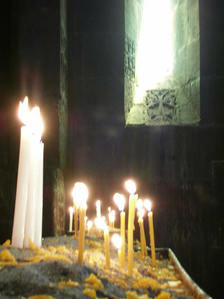 Candles alight for the fortunate in a small hilltop church in rural Armenia.