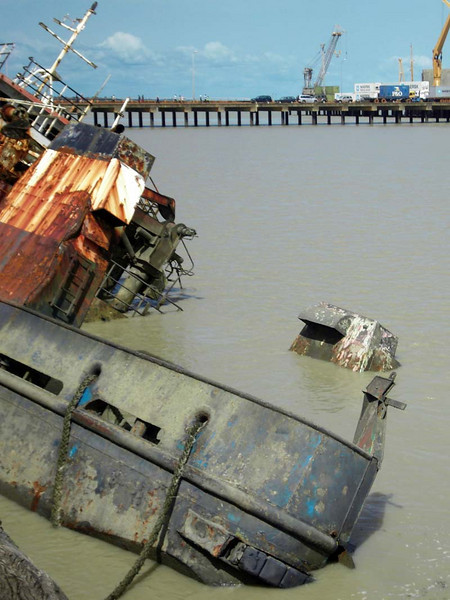 Underlying the desperation of this small country, sunken vessels line the commercial docks in the capital's main port!  Bissau, Guinea Bissau.