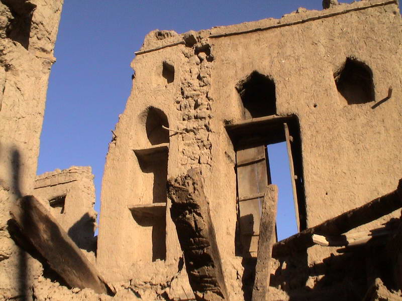 Abandoned mud brick city forts in central Oman.