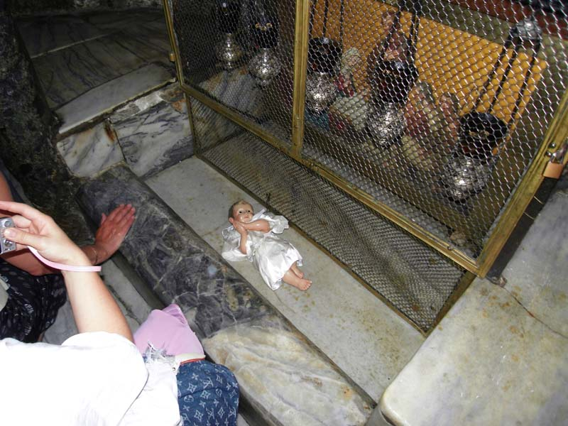 The baby Jesus poses for all and sundry in the basement of the holy Church of the Nativity in Bethlehem.