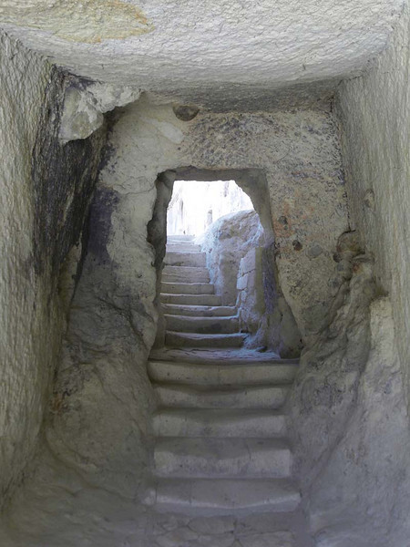 View into the inner caves of stone dwellings carved into the hillside of the Zelve open air museum in Kapydokia Turkey.