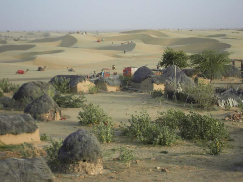 Indigenous huts on the desert fringe in Jaiselmer, Rajastan India.