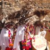 A charismatic feathered marching band parades by during the Inti Raymi celebrations in Sacsayhuanman near Cuzco Peru.