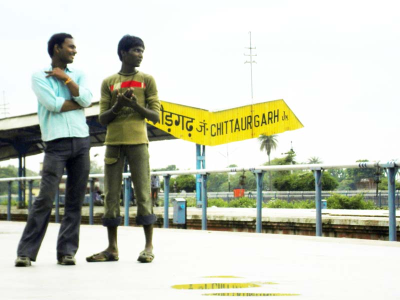 Guys on the platform in Chittaugaur, Rajastan India.