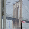 The Brooklyn Bridge pictured on an otherwise blank building face near South street Seaport, New York City