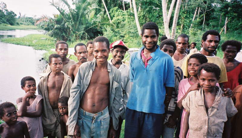 Friendly villagers greet our boat on the upper Sepik river, Papua New Guinea.