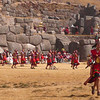 Dancers and musicians descend from the fortress to the plain during the Inti Raymi celebrations in Sacsayhuanman near Cuzco Peru.