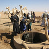 Lining up for a dip into a deep well, deep in the desert of Niger