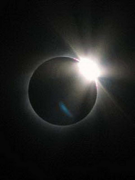 """The """"diamond ring"""" of the total solar eclipse above Bilma, Niger."""