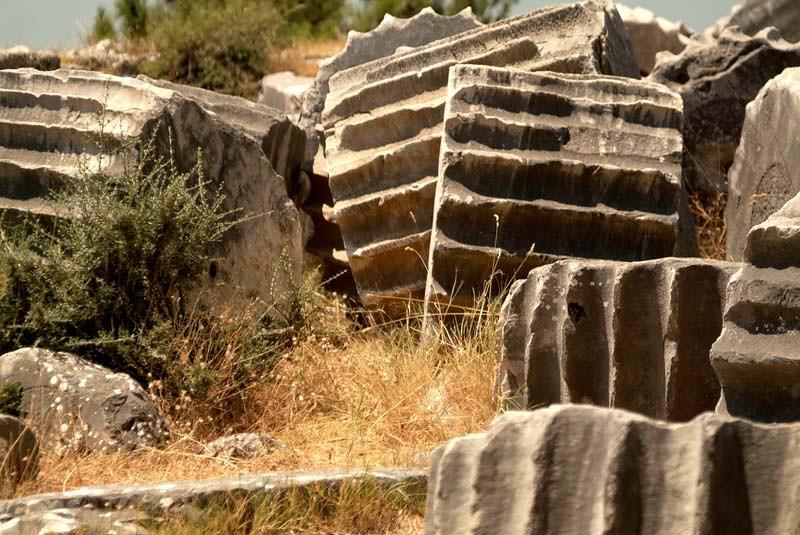 Cascading column sections cast aside amidst the rubble of Preine, along the Agean coast, eastern Turkey.