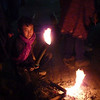 An apprentice assists with the preparation of the torches during the night-long Yadna Kasada festivities at Mt Bromo, East Java Indonesia.