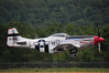 P51 Mustang taking off and folding up the landing gear at the Westfield (MA) Air Show in August