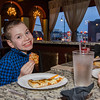 Huxley Callaschai, 9, takes a taste during the pizza judging contest at Destare on Thursday evening to determine the city's best pizza. SENTINEL & ENTERPRISE / Ashley Green