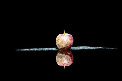 Apple in still light with creative filter. Keller, Texas