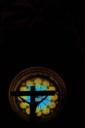 Cross and stained glass window. Lisbon, Portugal