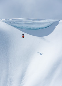Adam Ü backflipping off Rockstar Cornice at Mt Baker
