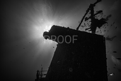 Sun over the stern of the Odyssey wreck (B&W)