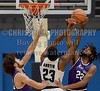 Millsaps' Tysin Meads (left) and James Turner (22) defend the basket against JSU's Darius Austin (23) on Friday, November 10, 2017, at Jackson State University in Jackson, Miss.