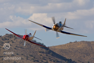 "Some close racing between two Hawker Sea Furies in the 2007 Unlimited Class Gold Race: Stu Dawson in Race 105, ""Spirit of Texas"", leads Robert ""Hoot"" Gibson in Race 99, ""Riff Raff"" down the ""Valley of Speed"" on the west side of the Unlimited race course at Reno.  Dawson finished the race in third place at a speed of 432.245 mph, with Gibson following in fourth with a speed of 432.09 mph."