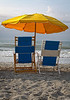 "Greetings From | This image says ""Summer"" to me. When people see this image they immediately see themselves sitting in the chairs looking out on the beach. The location can be anywhere there is ocean. This image was captured early morning on Myrtle Beach, SC."