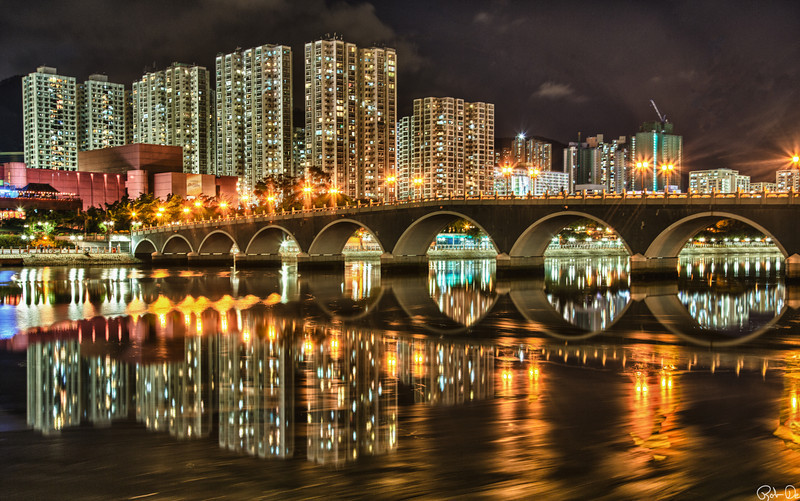 Lek Yuen Bridge | A foot bridge found in the new territories of Hong Kong crosses the Shing Mun river.  This bridge provides a majestic view of the downtown area.