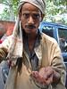 Beggar at my car window. New Delhi, 2007.