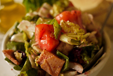 Fattoush, crispy fried pita and fresh vegetables in a delicious and light oil with sumac for a tangy and tart flavor.