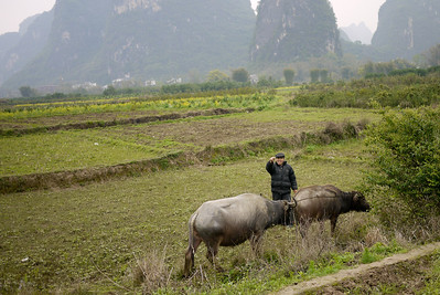 A farmer sends a hello as we pass by on our bikes outside of Yangshuo, China.