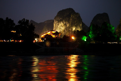 Karst rocks on the Li River are lit at night in Yangshuo, China.