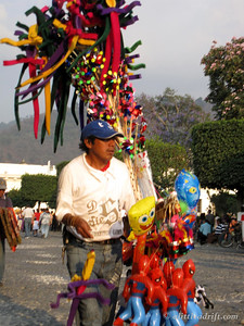 Toy Vendor Hawking His Wares